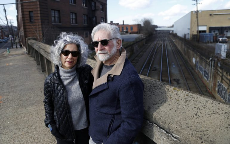 North Side residents Barbara Talerico and her husband Glenn Olcerst are leading the fight against a $29 million proposal by Norfolk Southern Corporation to run double-stack train traffic from the North Side through the center of Pittsburgh's East End. (Photo by Ryan Loew/PublicSource)