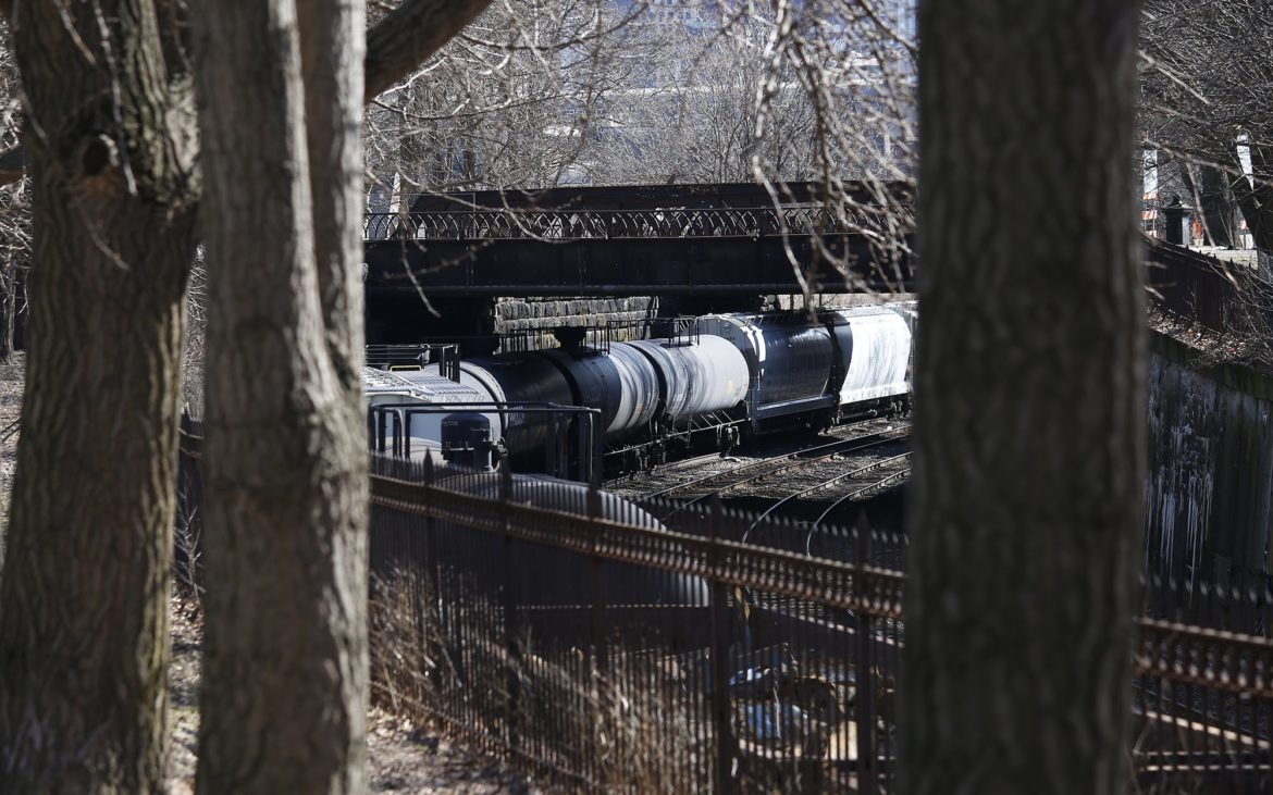 A rail company claims a faster route through Pittsburgh for double-stack trains will reduce pollution. Here's why some remain opposed.