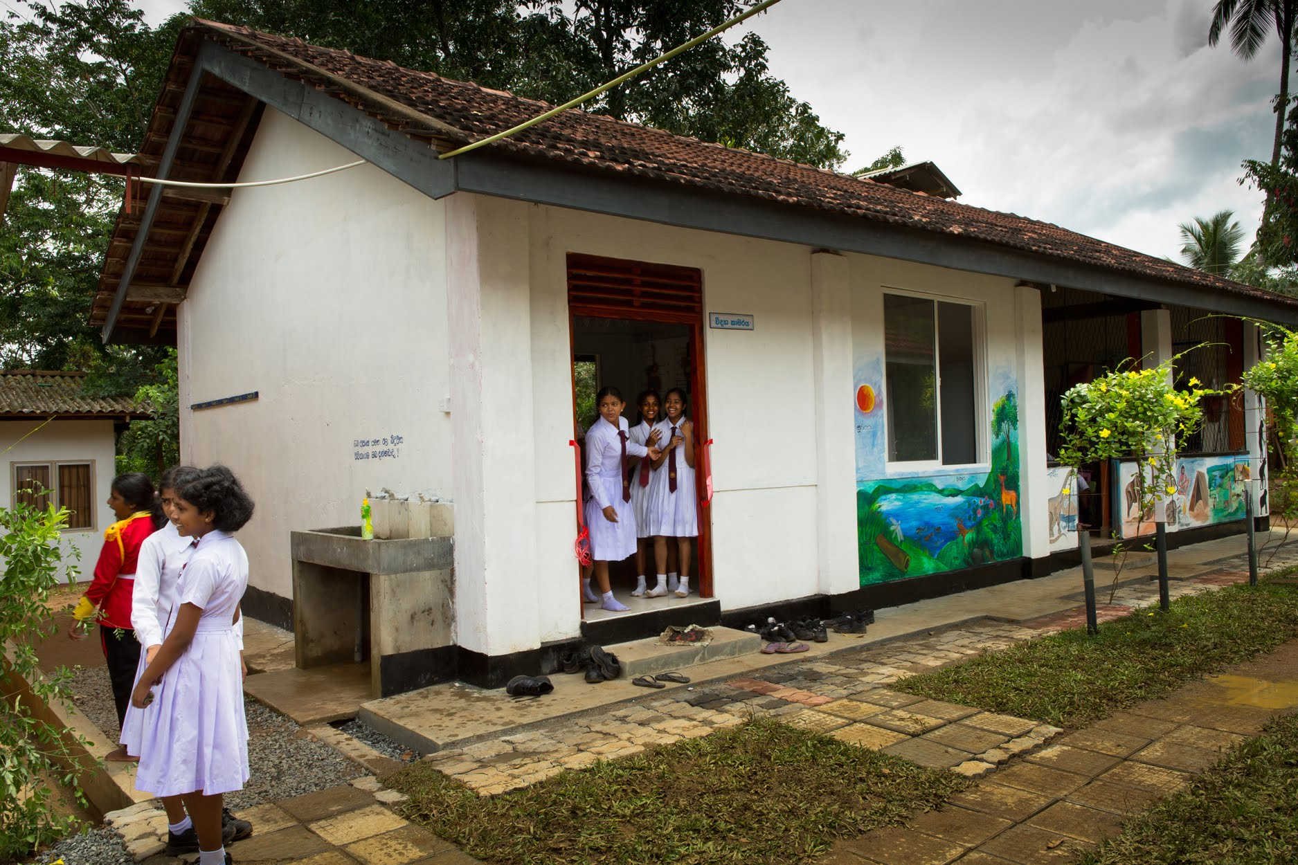 The new science lab at Palpita School cost $4,000 U.S. to renovate from the original open pavilion. Inside, it has tile floors, new walls, windows, ventilation, tables and cases of brand new scientific glass, textbooks and models.