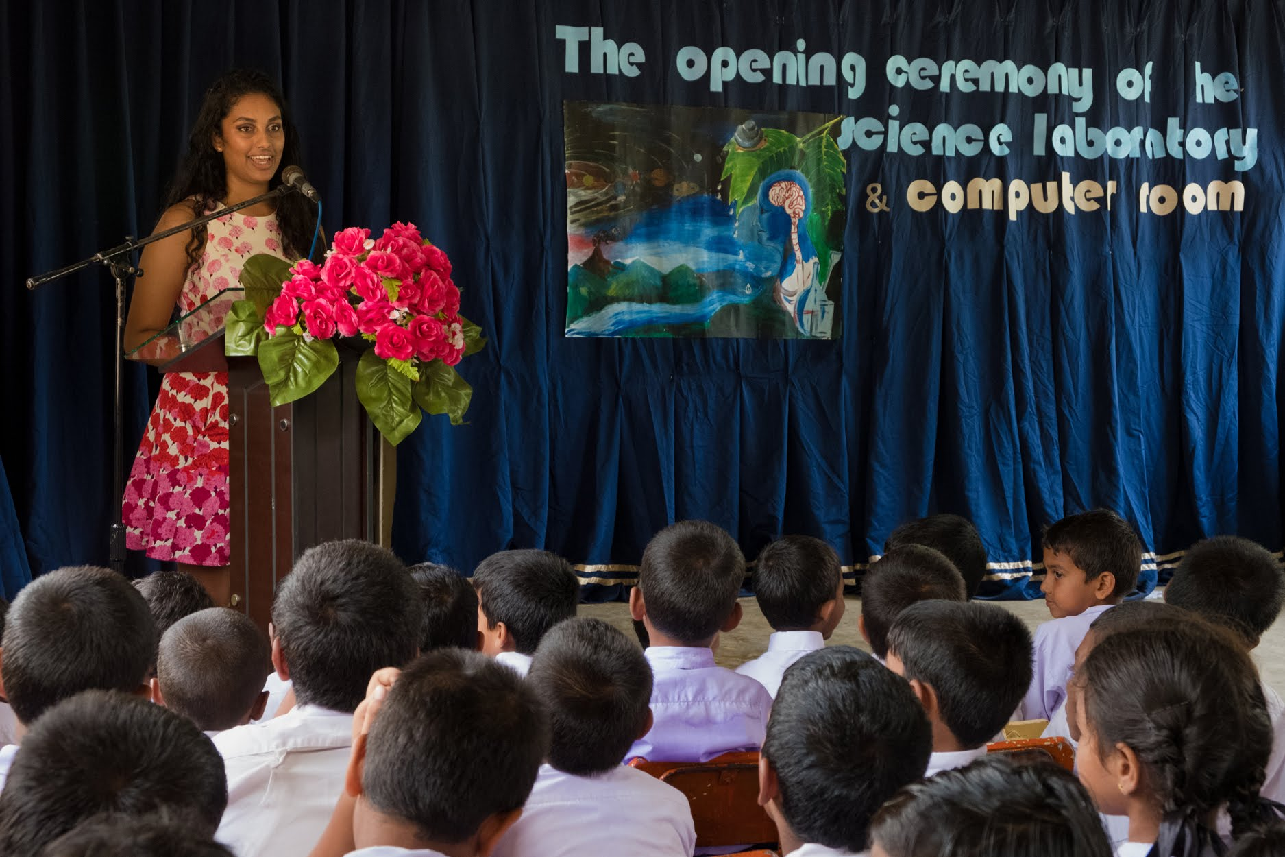 As a guest of honor, Hiruni presents a short speech she prepared to students, parents, and teachers at Palpita School during the dedication of the science lab she funded through her Close to My Heart Foundation.