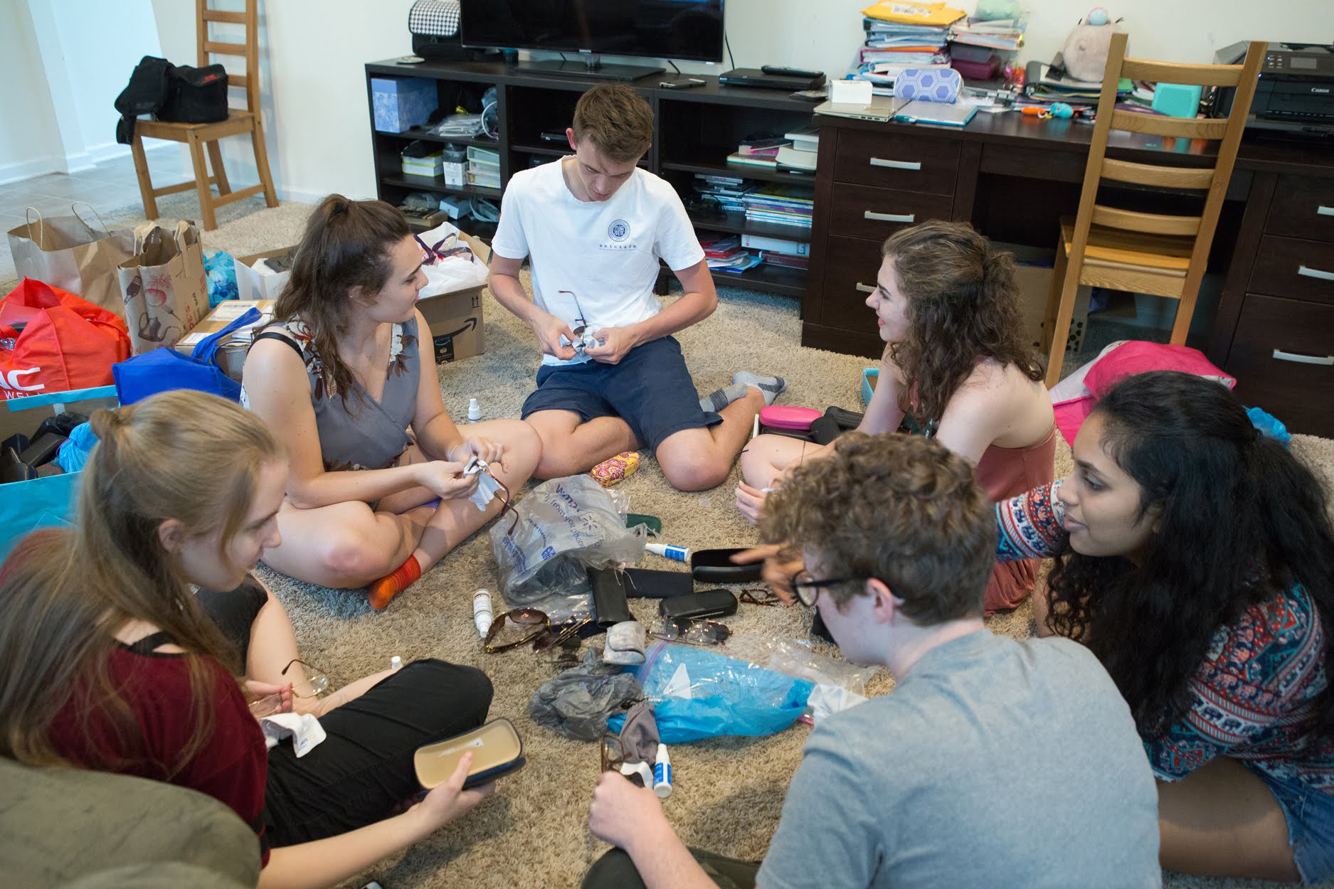 Hiruni's friends from Seneca Valley High School gather at her house in early June, 2018, to help sort, clean and wrap donated pairs of eyeglasses collected throughout the previous year. In total, Close to My Heart provided over 1,000 pairs of glasses for the August clinic.