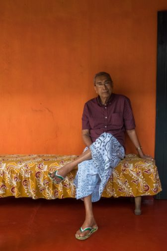 Walter Singhabahu, 89, relaxes in a traditional Sri Lankan sarong inside the courtyard of his Pugoda home. Many local Sinhalese men, old and young, prefer the comfort of the sarong to pants or shorts because of the island's tropical heat and humidity. And many men who dress in trousers during the day for work, will come home and immediately don their sarongs instead for their relaxation time.