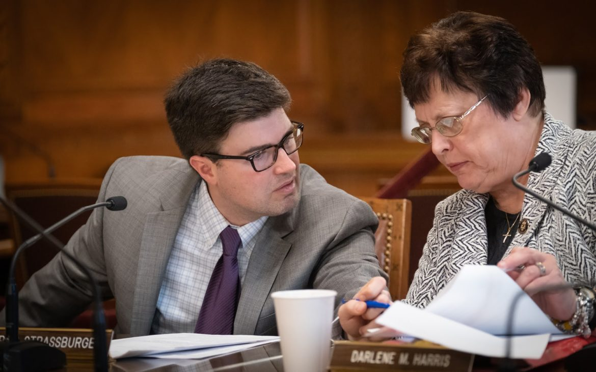 Councilman Corey O'Connor discusses an issue with Councilwoman Darlene Harris during Wednesday morning's council meeting. (Photo by Terry Clark/PublicSource)