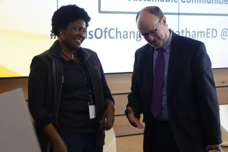 "Ariam Ford talks with David Finegold, the president of Chatham University, after her keynote address at the third annual Seeds of Change sustainability conference. ""Place-making is hard,"" Ford told students. ""What's harder is creating spaces that are for everyone."" (Photo by Oliver Morrison/PublicSource)"