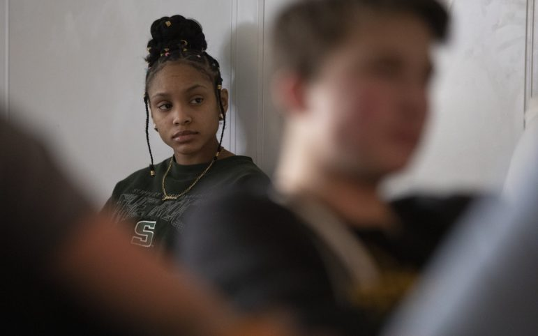 "Janae Williams, a student in the eleventh grade at Northgate Middle/Senior High School, watches ""Hamlet"" in her advanced placement literature class. (Photo by Kat Procyk/PublicSource)"