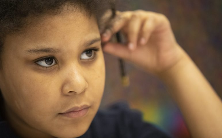 Angelina Estes, a fifth grader at Propel McKeesport, listens to her teacher in her English class. (Photo by Kat Procyk/PublicSource)