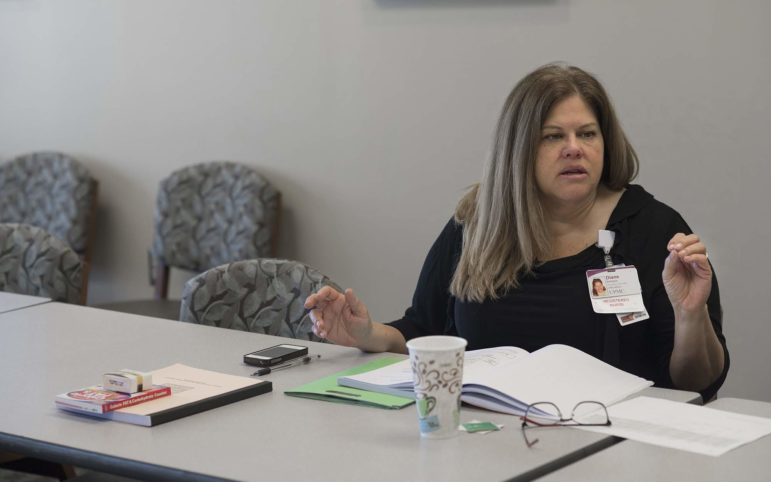 Registered nurse Diane Battaglia discusses portion control with patients participating in her diabetes prevention class at UPMC Mercy South Side Outpatient Center. (Photo by Martha Rial/Pittsburgh Magazine)