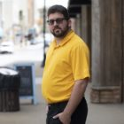Joey D'Auria stands on a street in Pittsburgh.