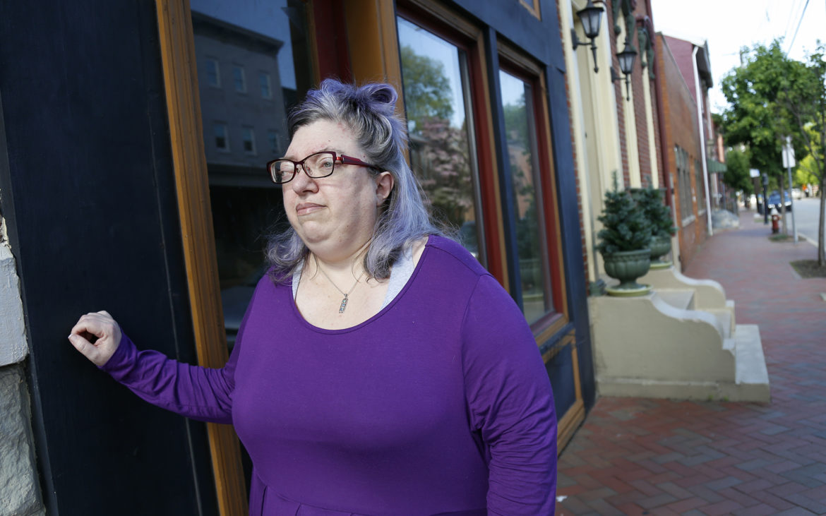 Sue Kerr worries that the experiences of LGBTQ elders in the Pittsburgh area are being lost to history. Kerr stands outside the former location of K.S. Kennedy Distinctive Floral, a gay-owned business on North Side that closed after proprietor Kerry Kennedy died in July. (Photo by Ryan Loew/PublicSource).