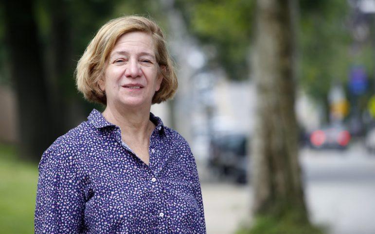 Sabina Deitrick poses next to a faded crosswalk