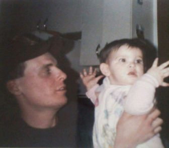 Brittany, as a child, being held up by her father in a childhood picture.