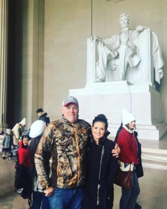 Brittany and her father posing in the Abraham Lincoln Memorial in Washington D.C.