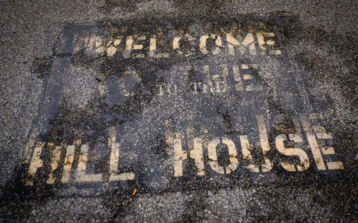 A welcome to the Hill House message is painted on the sidewalk in front of the James F. Henry Hill House Center along Centre Avenue in the Hill District on June 28, 2019. (Photo by Justin Merriman/PublicSource)