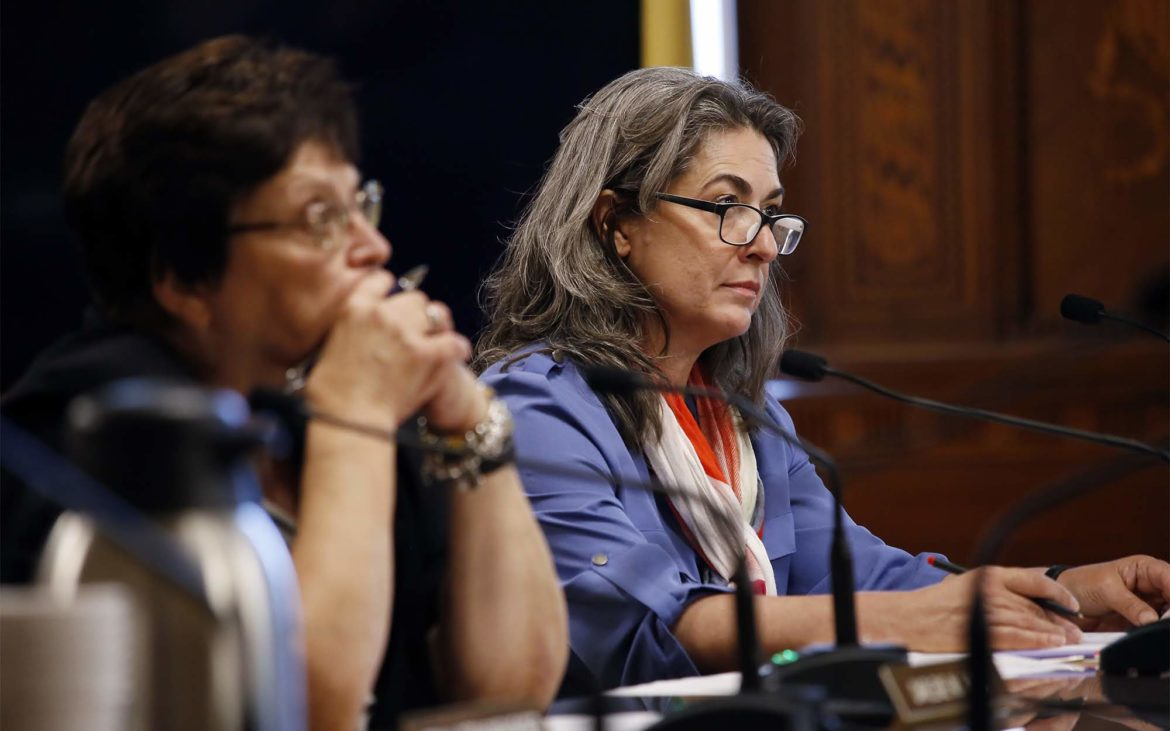 Pittsburgh City Councilwoman Deb Gross (right) listens to public comment during a Tuesday hearing on inclusionary zoning in Lawrenceville. (Photo by Ryan Loew/PublicSource)