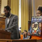 Darrell Kinsel, community engagement and program manager for Lawrenceville United, speaks in favor of inclusionary zoning at a Pittsburgh City Council hearing on Tuesday. Standing alongside Kinsel is Celeste Scott, housing and justice organizer for Pittsburgh United. (Photo by Ryan Loew/PublicSource)