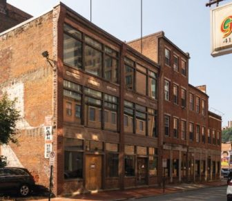 The set of 19th-century-era buildings on Market Street owner Michael Troiani woud like demolish to make way for a new office tower.(Image from the Planning Commission)