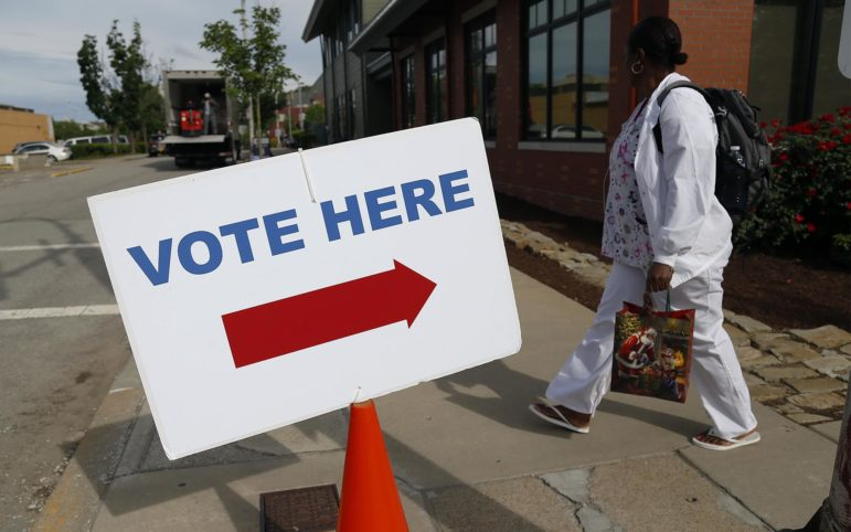 A resident walks near a polling place in East Liberty on May 21, 2019. (Photo by Ryan Loew/PublicSource)