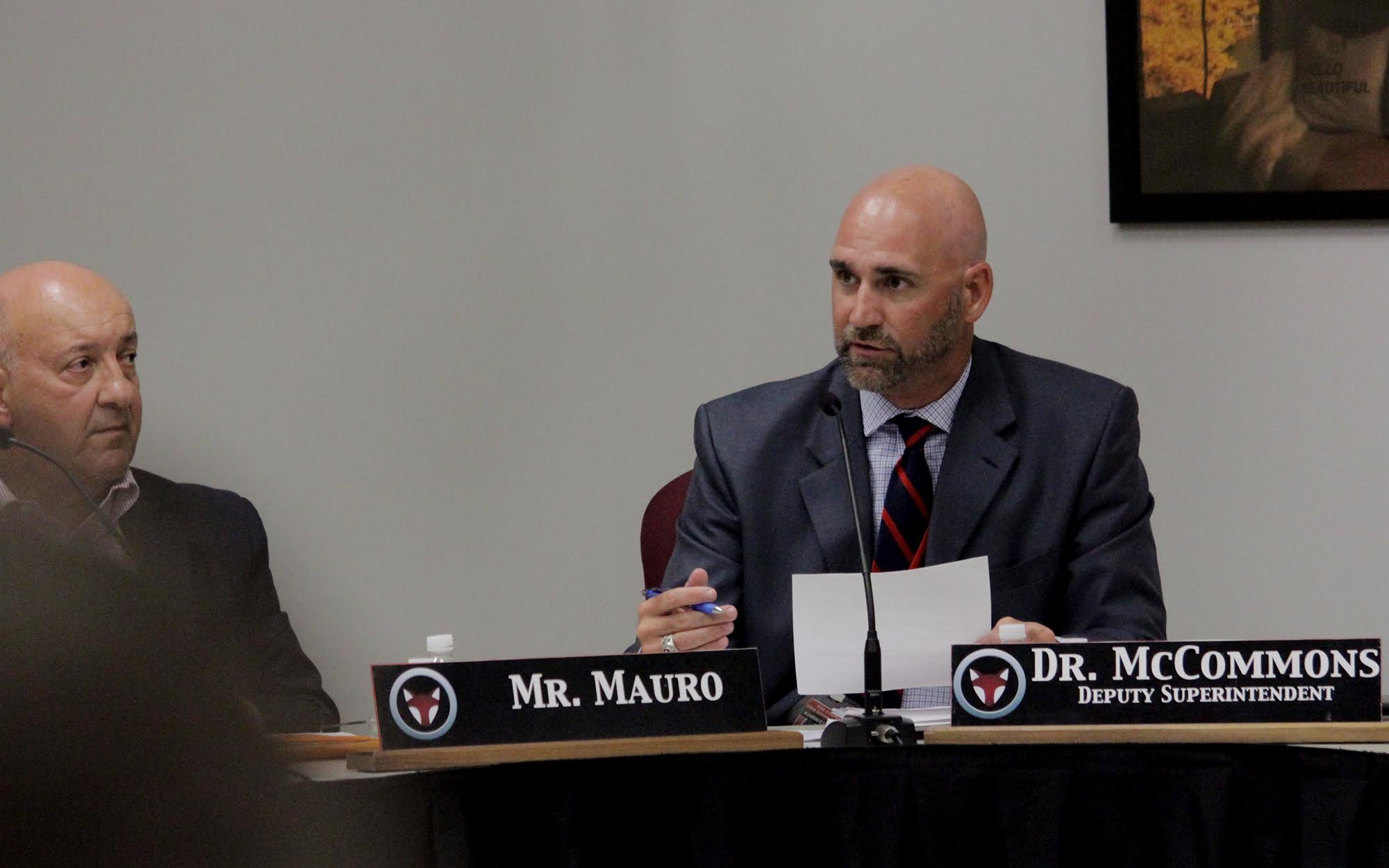David McCommons (right), Fox Chapel Area School District deputy superintendent and district Right-to-Know officer, addresses a question from the board during its Aug. 12 meeting. (Photo by Jay Manning/PublicSource)