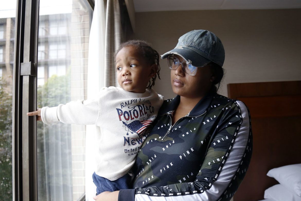 Nicole Nelson, 23, and her son Pharaoh Farrish, 2, were among those displaced by a fire on De Ruad Street in West Oakland on Aug. 17. (Photo by Ryan Loew/PublicSource)