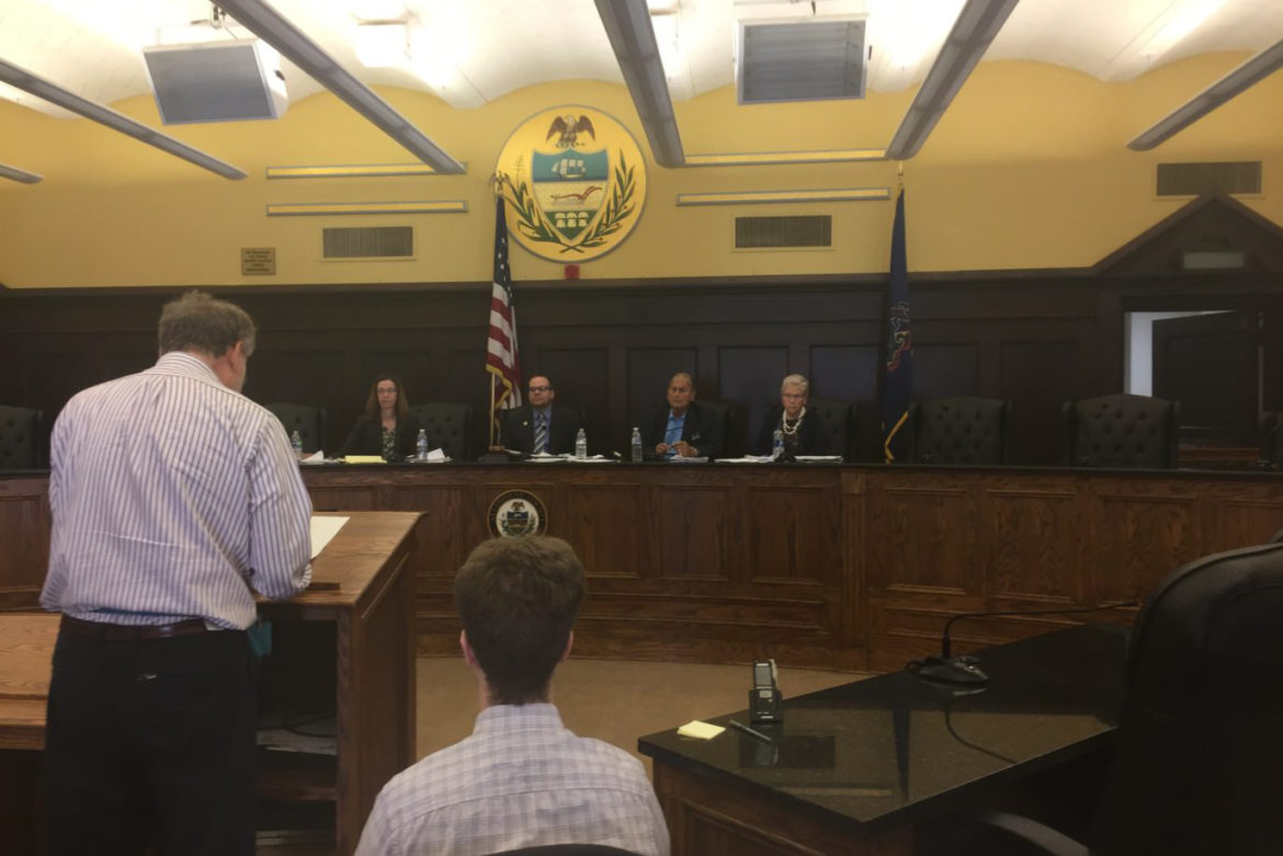 A resident speaks before Allegheny County interim Board of Elections. From left: County Judge Kathryn Hens-Greco; Republican County Council member Tom Baker; Democratic County Council member John DeFazio. County Councilwoman Sue Means, far right, sat in on the proceedings. (Photo by J. Dale Shoemaker/PublicSource)
