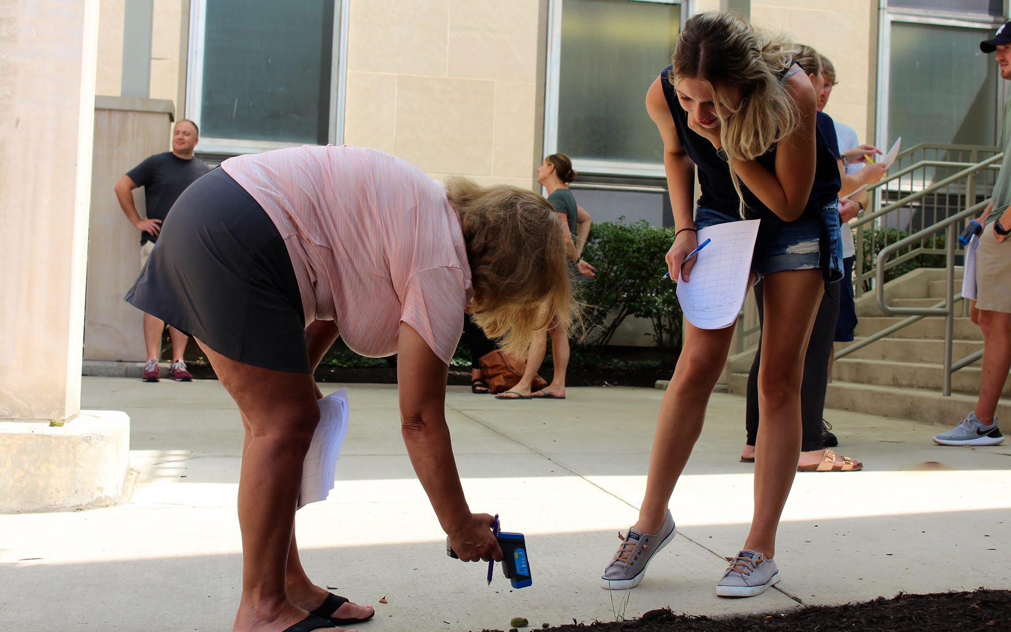 Alderdice High School Biology teachers Angela Linderfelser (left) and Maria Deihl (right), measure and capture temperature data on model frog for climate change experiment at University of Pittsburgh