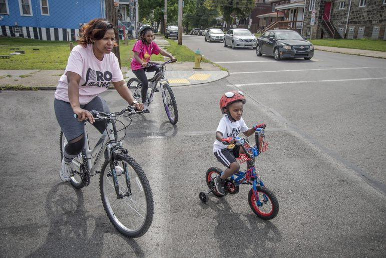 Jenelle Gordon biking with her daughter Samaudi and son Ezra during a Healthy Ride group ride in Homewood on Aug. 10, 2019. (Photo by Teake Zuidema/Publicsource)