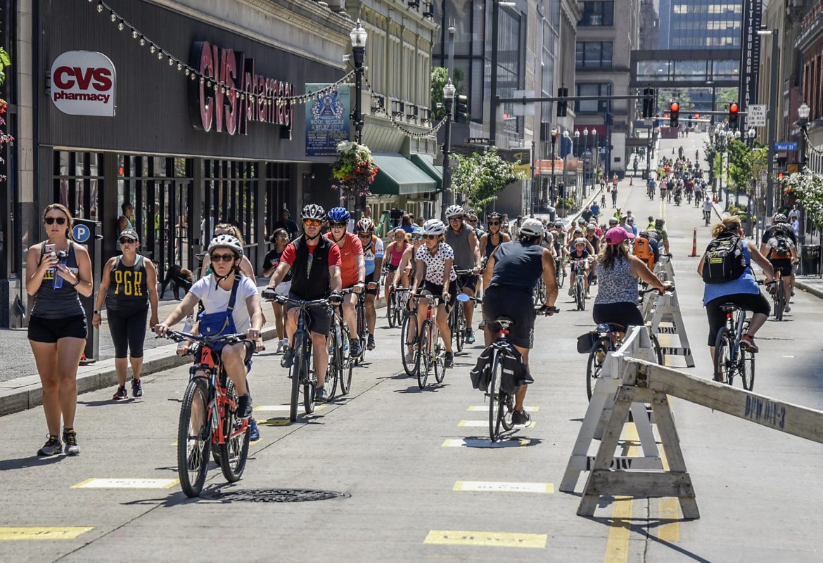 Bikers on Forbes Avenue in Downtown during a July 28, 2019 Open Streets event. (Photo by Teake Zuidema/Publicsource)