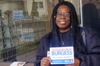 Brenda Alston of Homewood in East Liberty. volunteered to pass out voter information on behalf of councilman Rev. Ricky Burgess. (Photo by Jourdan Hicks/PublicSource)