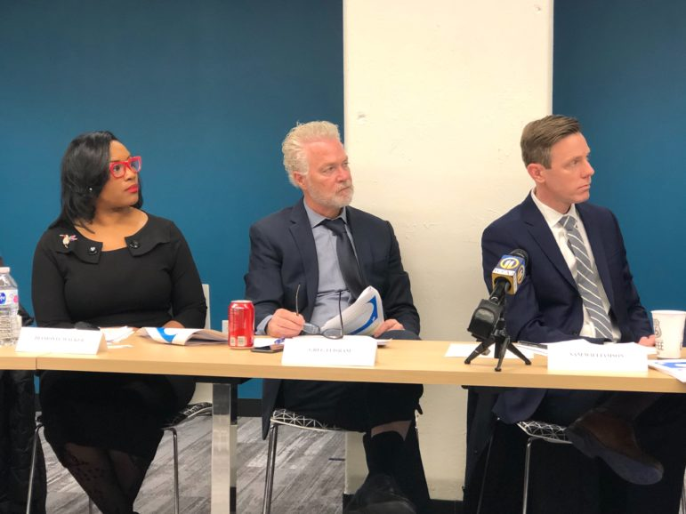 Greg Flisram (center), new executive director of the Urban Redevelopment Authority, at his first board meeting. Also pictured are Diamonte Walker (left), the URA's deputy executive director, and board president Sam Williamson (right). (Photo by Juliette Rihl/PublicSource)