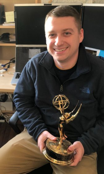 Ryan Loew holds his Emmy award.