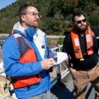 Oliver Morrison talks to the Army Corps of Engineers about one of their lock and dam projects for a story about the Ohio river. (Photo by Ryan Loew/PublicSource)