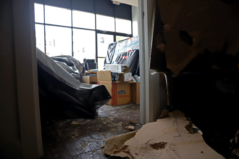 Fire and water damage caused the ceiling of one of The Corner's storage areas to fall. (photo by Jay Manning/PublicSource)