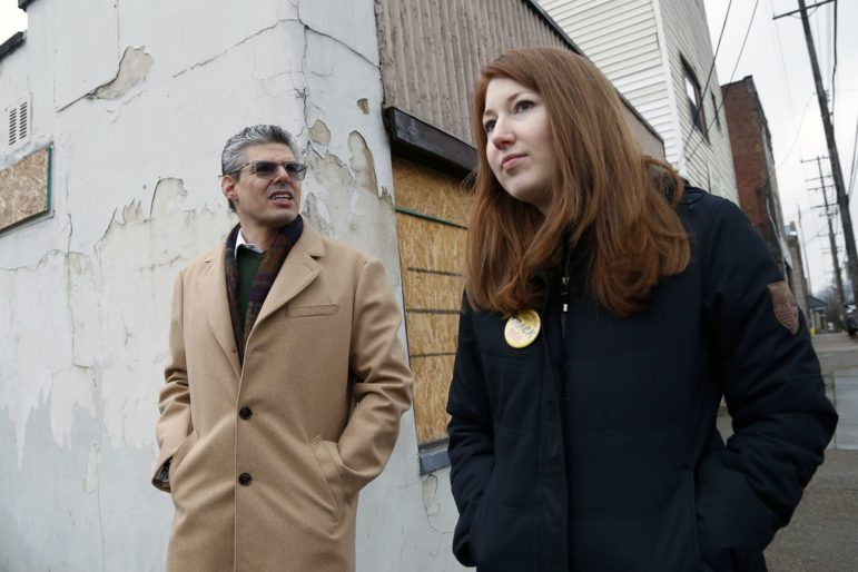 East Pittsburgh Borough Manager Seth Abrams and Councilwoman Stacey Simon walk along Bessemer Avenue in East Pittsburgh. (Photo by Ryan Loew/PublicSource)