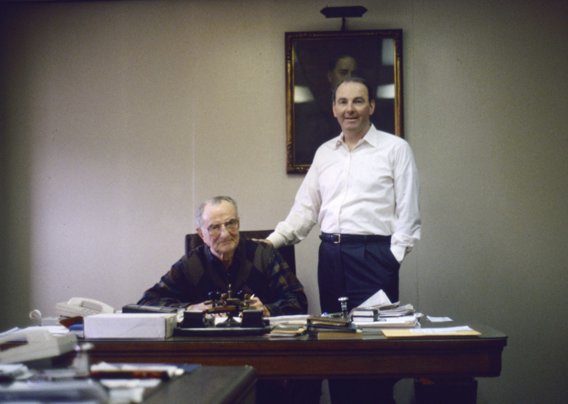 Roy Kumer (seated) and Jeff Kumer in the Pittsburgh Wool Company office in 1997. Behind them is a portrait of the company's founder, W.P. Lange. (Photo by David S. Rotenstein)
