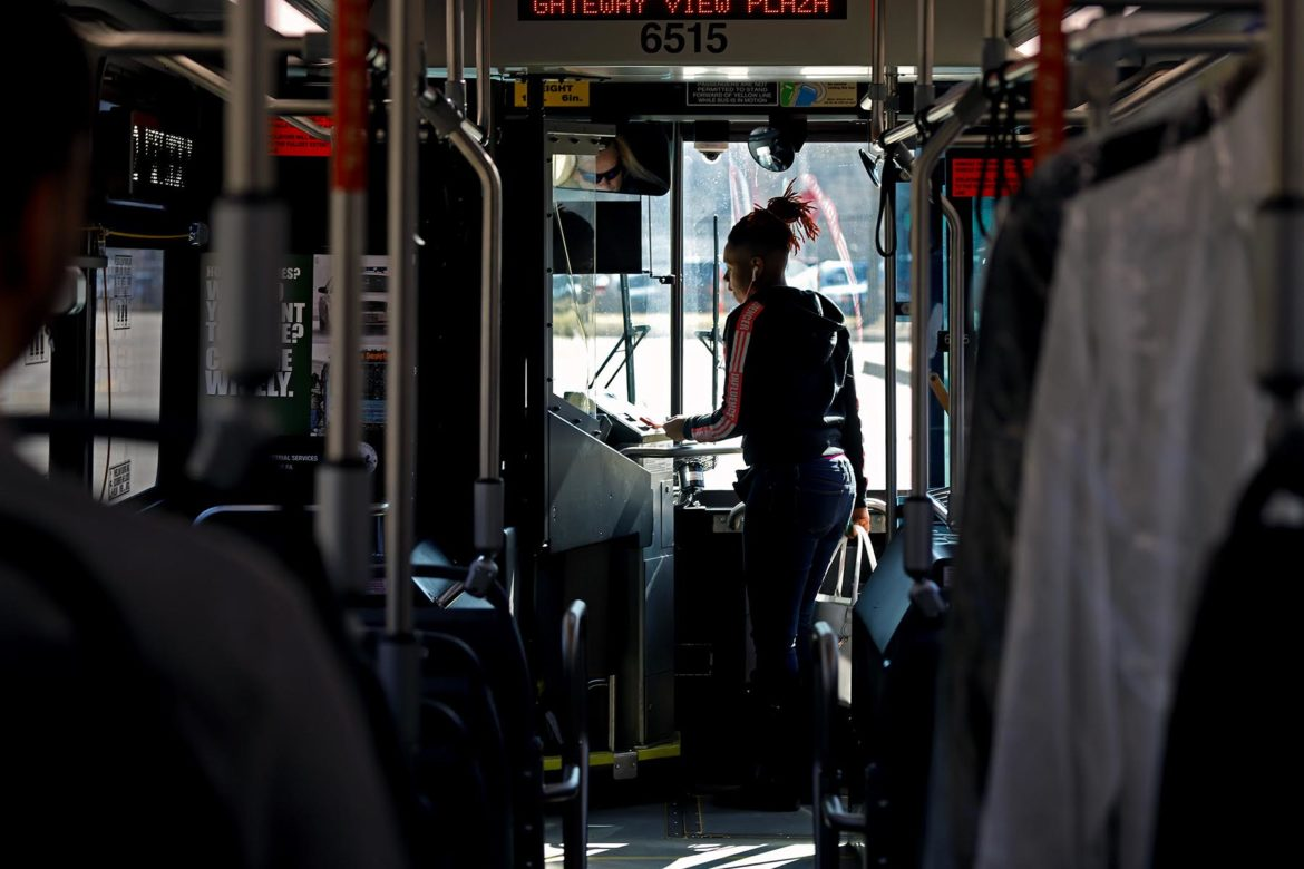 Pittsburgh resident paying bus fair before riding (Photo by Jay Manning/PublicSource)