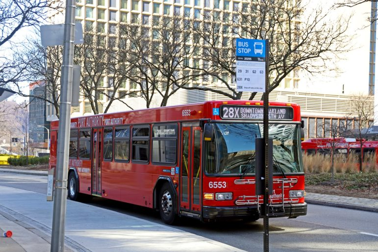 A Port Authority bus on Liberty Ave. in Downtown Pittsburgh. (Photo by Jay Manning/PublicSource)