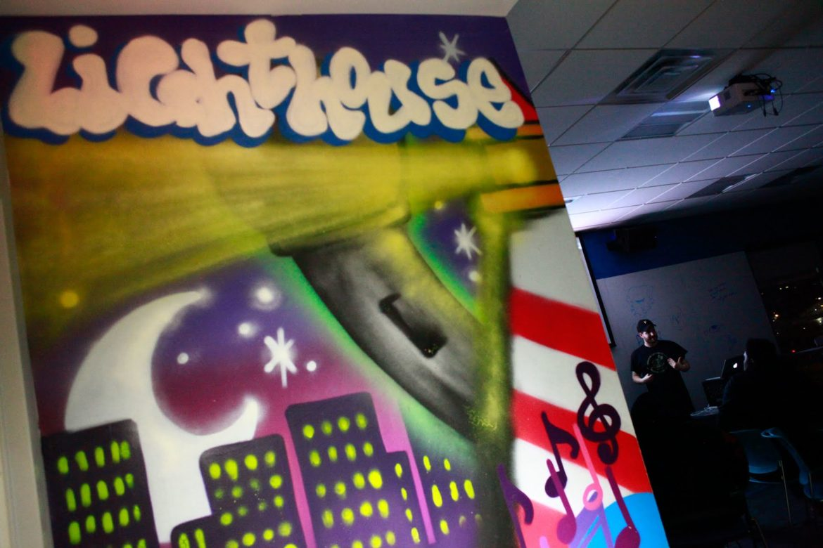 A mural painted on the wall at the entrance of the deejaying class at the Lighthouse Project at the YMCA in Homewood. (Photo by Kimberly Rowen/PublicSource)