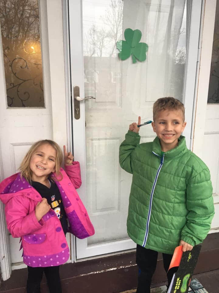 Max, 7, and Lexi Frisco, 4, hung a shamrock on their Brighton Heights home for peers to find and went out to look for some themselves with mom, Kristy.