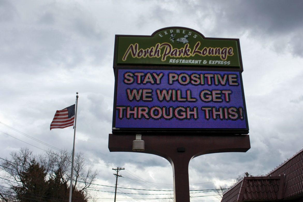 "The sign at North Park Lounge in the North Hills on March 20 reads, ""Stay positive we will get through this."" (Photo by Kimberly Rowen/PublicSource)"