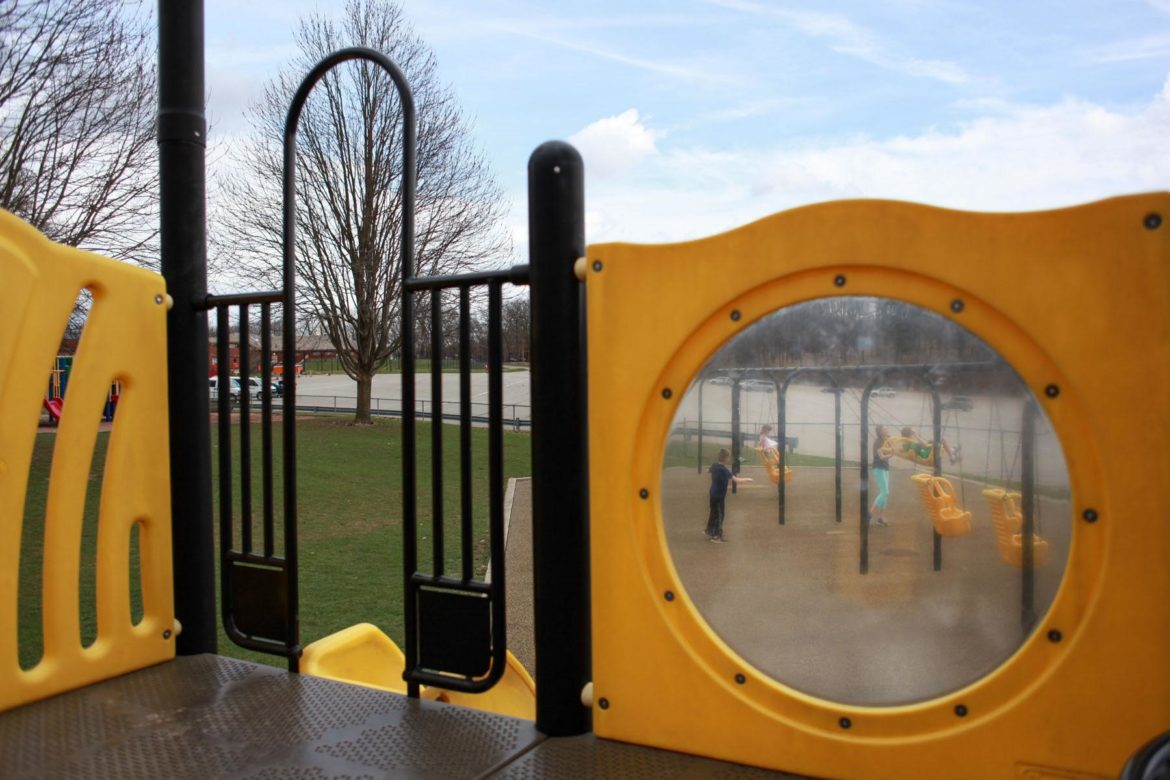 Four children play on an otherwise empty playground at North Park on March 20. (Photo by Kimberly Rowen/PublicSource)
