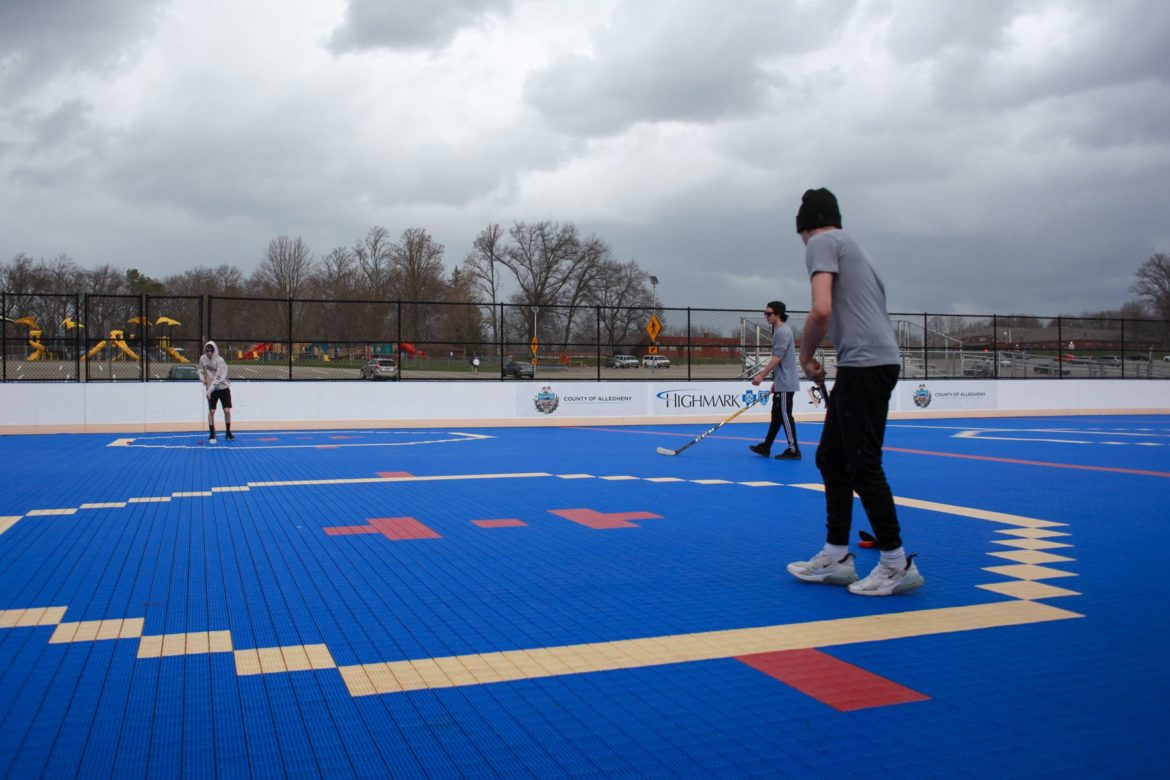 People play dek hockey at North Park on March 20. (Photo by Kimberly Rowen/PublicSource)