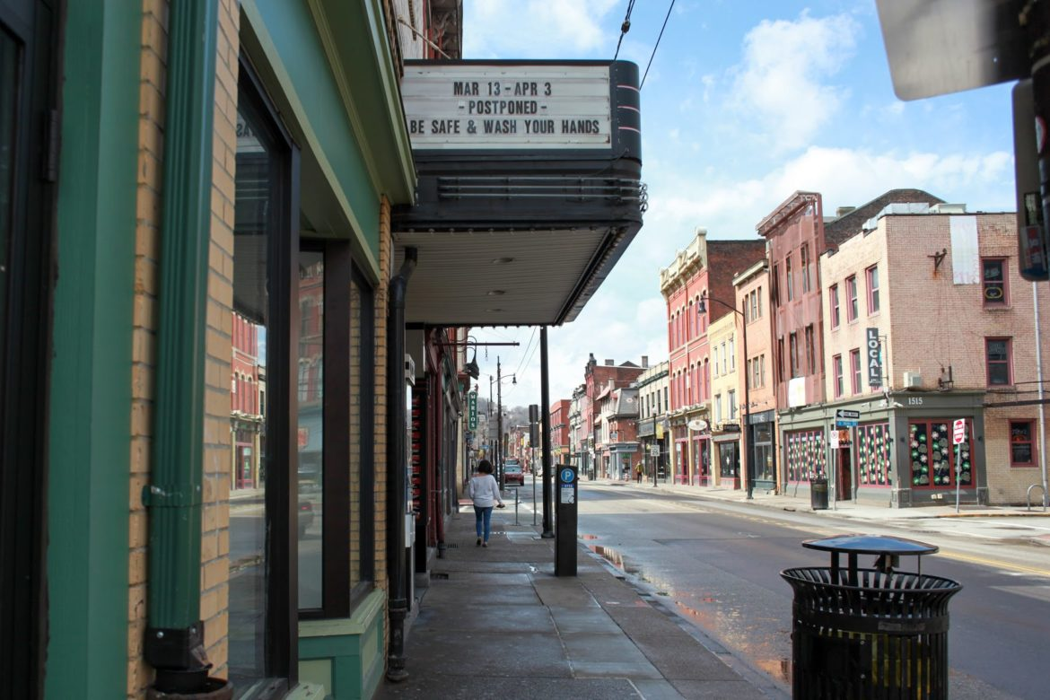 The marquee at the Rex Theater in the South Side on March 20 reminds everyone to wash their hands. (Photo by Kimberly Rowen/PublicSource)