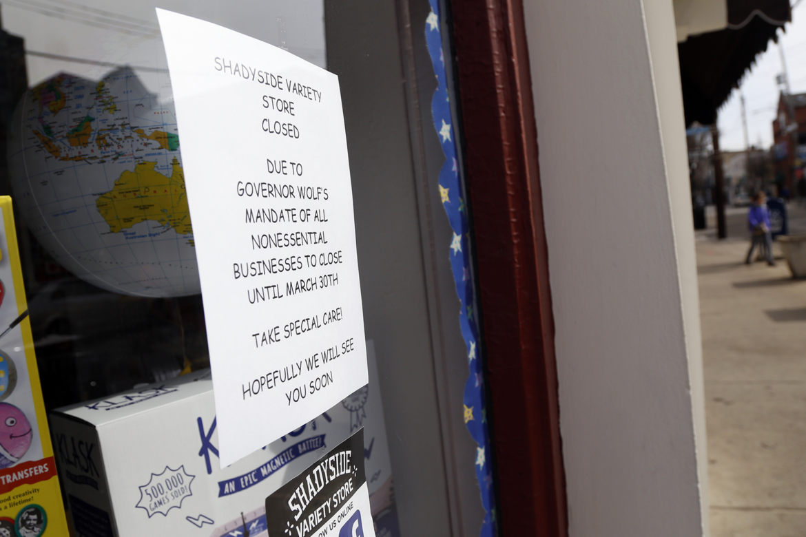 A sign in a window of Shadyside Variety Store seen on March 18. (Photo by Ryan Loew/PublicSource)