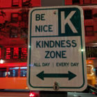 """Street sign that reads """"Kindness Zone"""""""