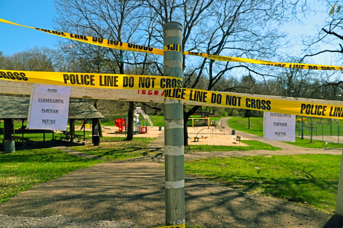 Closed signs and police barricades at a park in Ingram, PA. (Photo by Jay Manning/PublicSource)