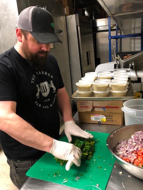 Spencer Warren, the owner of Warren Bar and Burrow, prepares meals for food industry workers. (Photo Courtesy of Warren Bar and Burrow)
