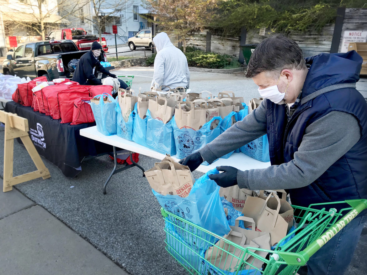 Dan Wonders, the Transportation Resource Coordinator for North Hills Community Outreach, helped distribute 125 meals in Millvale recently, more than double what the site normally gives out. (Photo by Jeff Geissler/North Hills Community Outreach)