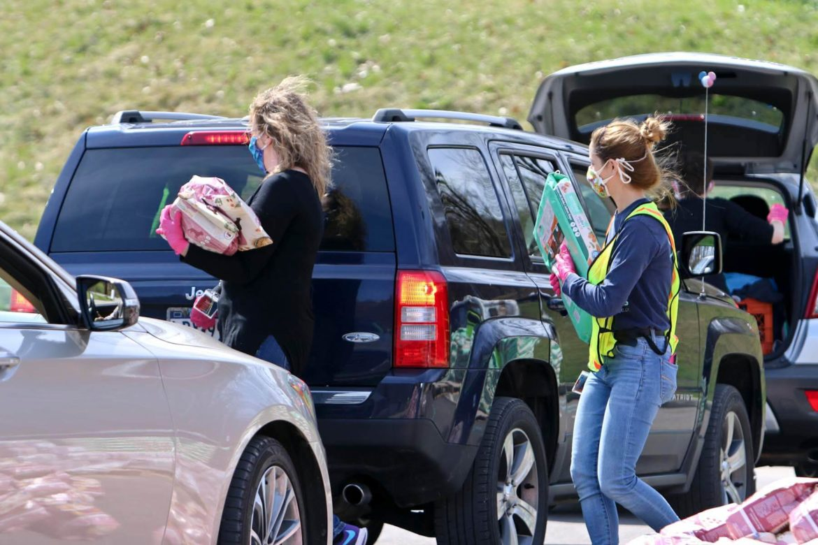 Animal Friends held a no contact drive-thru emergency pet food distribution on April 11. Individuals were asked to stay in their cars as food was loaded into their vehicle by staff members and volunteers wearing gloves and face masks. (Photo by Kimberly Rowen/PublicSource)
