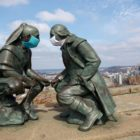 The sculpture of Seneca leader Guyasuta and George Washington on Pittsburgh's Mt. Washington don masks amid the coronavirus pandemic. (Photo by Kimberly Rowen/PublicSource)