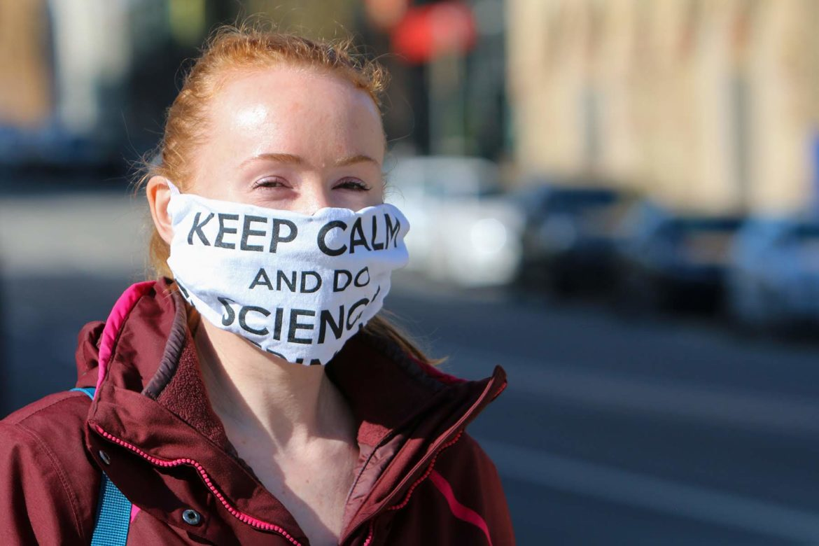 A pedestrian in Oakland wears a face mask on April 6. (Photo by Kimberly Rowen/PublicSource)